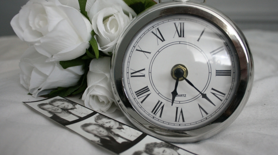 pocket watch with white roses and photographs