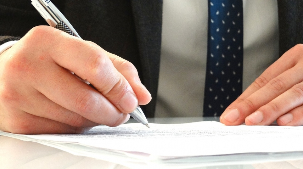 sign a legally binding settlement negotiated through an independent mediator