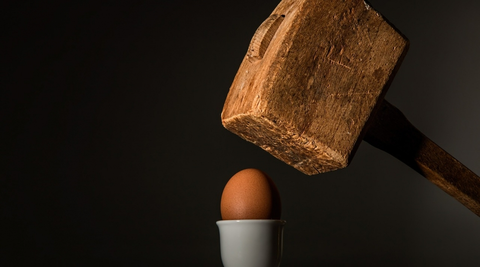 cracking an egg with a sledgehammer